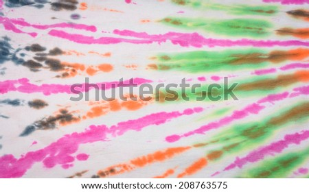 old style colorful tie and dye fabric pattern detail as background - stock photo