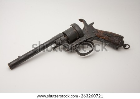 old style colt revolver rusted and damaged