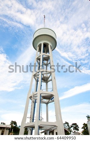 Old style concrete water tank in blue sky