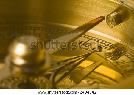 Old style gold compass closeup. Points to $