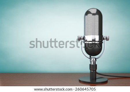 Old Style hoto. Retro Microphone on the table - stock photo