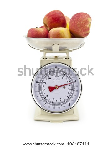 Old style kitchen scales with Apples on white background Isolated - stock photo