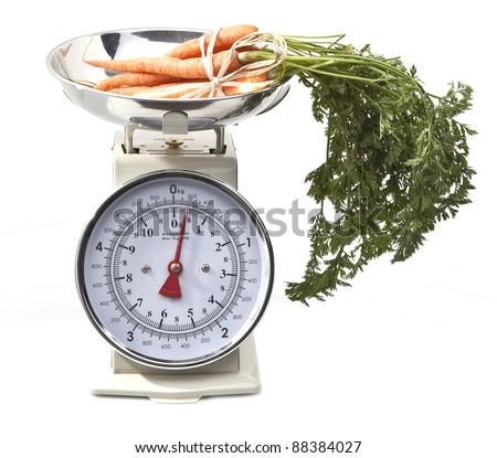 Old style kitchen scales with carrots on white background Isolated - stock photo