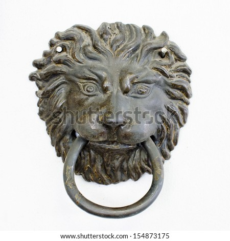 old style lion's head knocker with rust