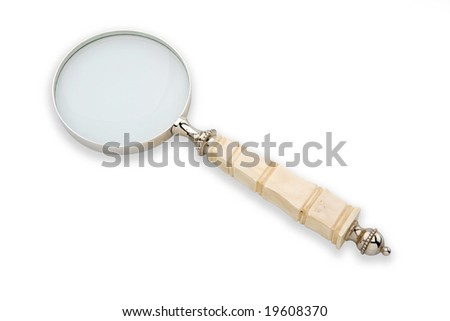 old style magnifying glass - stock photo