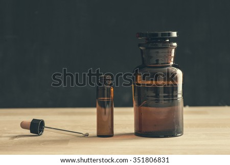 Old style medicine glass bottles. Concept of science research, healthcare and laboratory tests. - stock photo