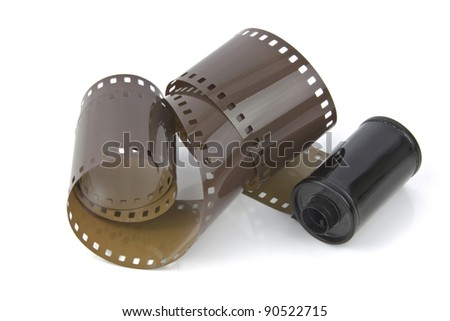 old style 35mm film pulled from its case - stock photo
