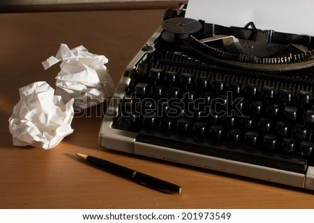 Old style office table,Typewriter with paper and pen, - stock photo