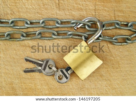 Old Style Padlock and Chain  - stock photo