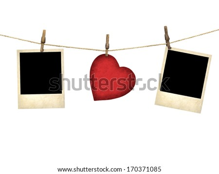 Old style photo and Valentine card heart shaped from old red paperr hanging on a clothesline isolated on white - stock photo