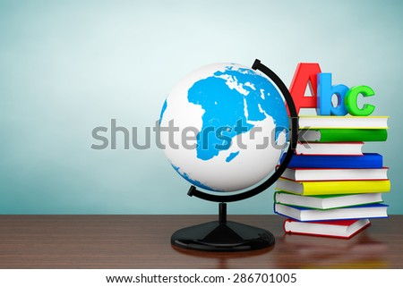 Old Style Photo. Books with ABC sign and World desktop globe on the table - stock photo