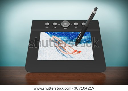 Old Style Photo. Digital Graphic Tablet with Pen and Sledges drawing on the table - stock photo
