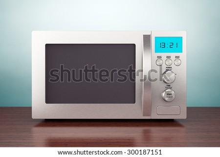 Old Style Photo. Microwave Oven on the table - stock photo