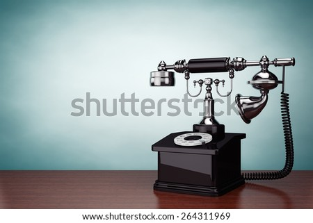 Old Style Photo. Vintage Telephone on the table - stock photo