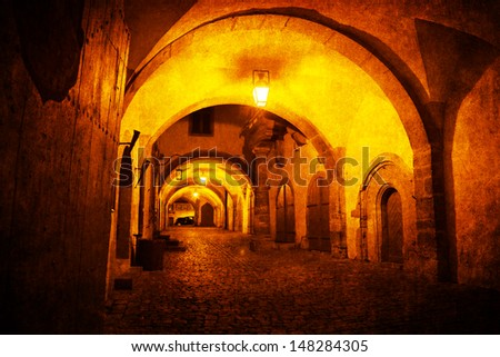 old style picture of a medieval archway of Rothenburg in Germany - stock photo