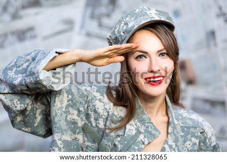 Old style portrait of an enthusiastic brunette army pin-up girl wearing uniform saluting for enrollment at a new recruit office - stock photo