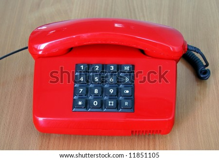 Old style red phone with buton mode for a call