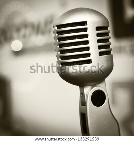 Old style retro microphone. - stock photo
