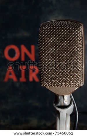 Old style retro microphone with on air sign and grunge background, vertical. - stock photo