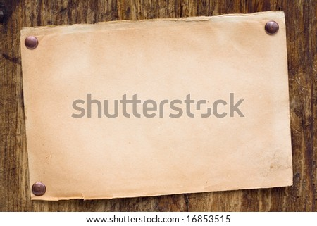Old style retro paper on wooden wall. Ready for your message - stock photo