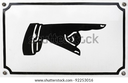 Old-style sign with human hand pointing the direction. - stock photo