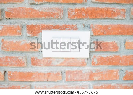 old style switches on red brick wall - stock photo