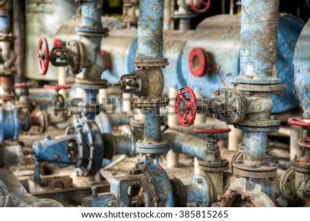 Old style valves in conlonial style sugar factory in Gondang Baru, Indonesia - stock photo