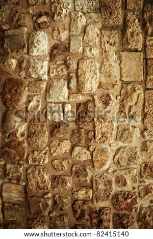 old style vintage cracked stone wall as background - stock photo