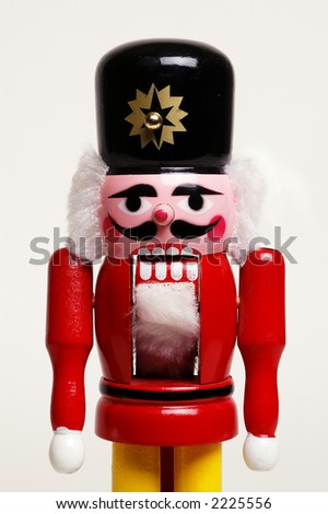 Old style wooden nutcracker in the shape of a soldier - medium shot on white