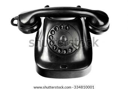 Old-styled black telephon with rotary dial isolated on white background - stock photo