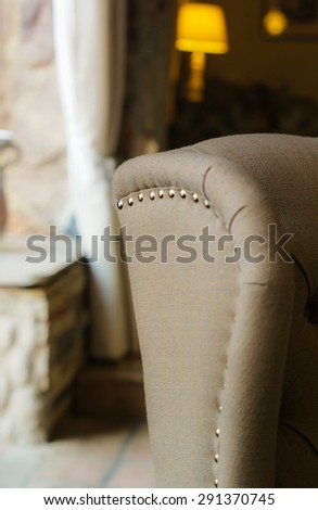 Old-styled chair in country interior - stock photo
