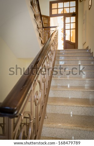 old-styled marble staircase with handrails in a hotel