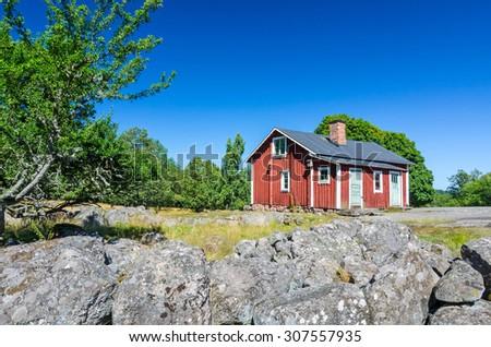 Old styled Swedish farm house - stock photo