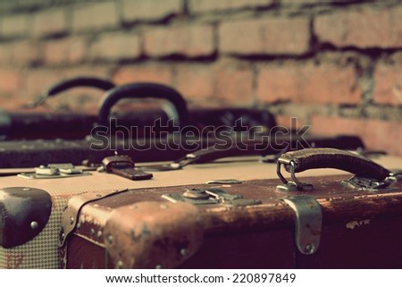 Old stylish brown suitcases with retro effect