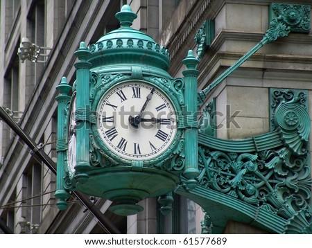 Old stylish clock on a street corner - stock photo