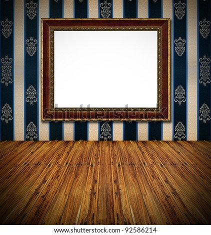 old stylish vintage golden frame on dark blue rich  textile decorated wall background and wooden massive rough planks floor foreground interior - stock photo