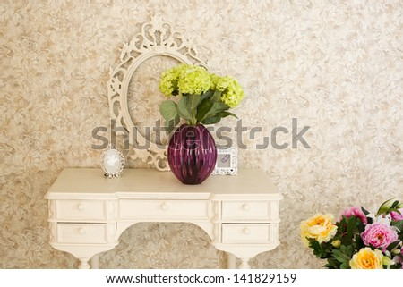 old stylized interior with white table and frame - stock photo