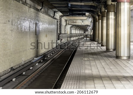 Old subway track in tunnel for train. - stock photo
