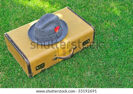 old suitcase and a hat