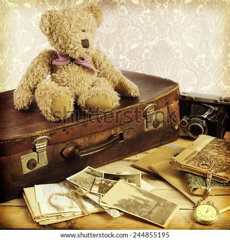 old suitcase, books, photos in retro style - stock photo