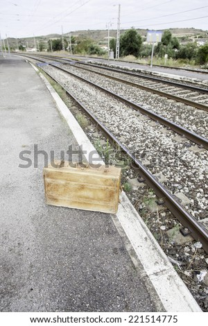 Old suitcase in a train station, detail of a vintage suitcase for travel - stock photo