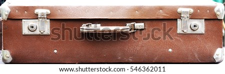 old suitcase threadbare and worn brown leather