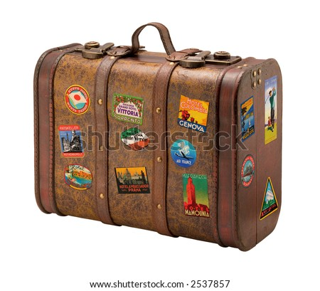 Old Suitcase Travel Stickers isolated  with a clipping path - stock photo