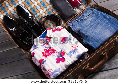 Old suitcase with beautiful fashion menswear. Clothes and accessories. - stock photo