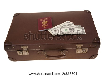 old suitcase with money and passport isolated on white background - stock photo