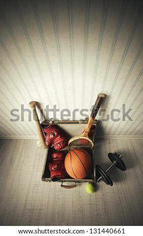 Old Suitcase with sports equipment - stock photo
