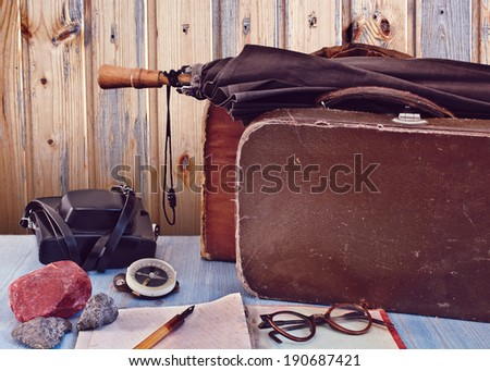 Old suitcases and a camera. Set traveler. Retro concept - stock photo