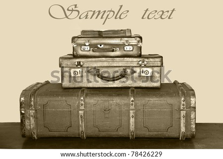 Old suitcases stacked up - stock photo