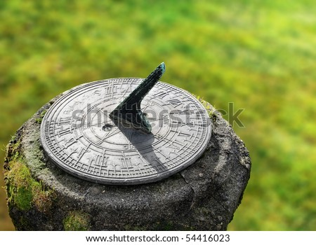 old sun clock dial in a garden - stock photo
