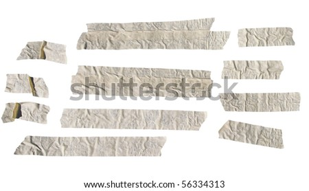 Old sun dried masking tape isolated on white - stock photo